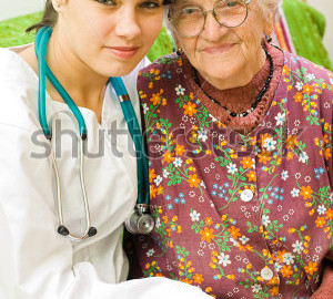 stock-photo-a-young-female-doctor-sitting-next-to-an-old-woman-26139085